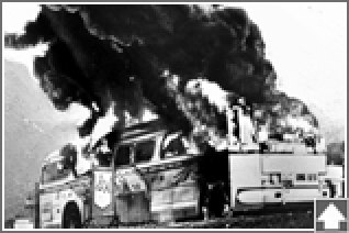 The burning Freedom Rider bus near Anniston, 1961