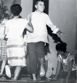 Terry Marshall and Alma Aletin dancing the Tinikling