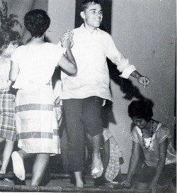 Terry Marshall and Alma Aletin dancing the Tinikling